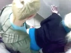 Horny teens fucking in the bathroom stall