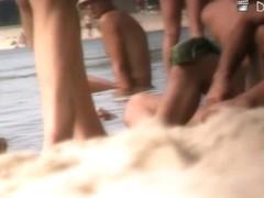 Voyeur nudist beach video with sexy blonde