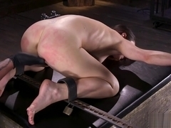 Shackled brunette gets pussy fingered