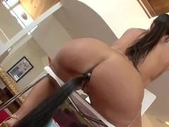 Cute pornstar Lisa Ann penetrates her asshole using horse's tail