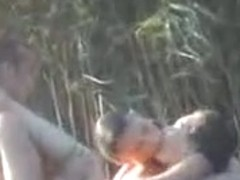 Three hot people having sex in the water caught on cam