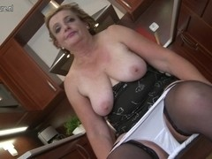Flawless grandmother playing in the kitchen
