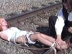 Ticklish Damsel Tickled on Railroad Tracks (nylon bare feet tickling)