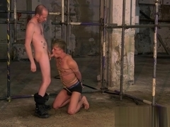 Restrained homosexual sub slave blows masters hard cock