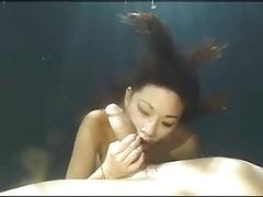 Oriental Girl Underwater Blow Job