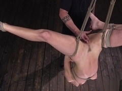 Brunette in upside down suspension whipped