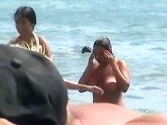 Buxom nude beach babes flaunt their jugs before a hidden camera