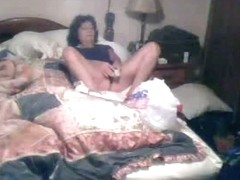 Mature fem takes dildo and packs cunt on home hidden porn