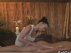 Huge tits oiled masseuse fingers her lesbian customer