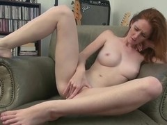 Dee Dee Lynn masturbates comfortably in a chair