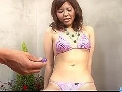 Reina Sakai uses dildo over her puffy Asian cunt