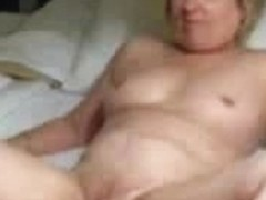 Old plump wife lays on her back and rubs her pussy