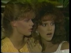 Two beautiful retro babes in their first lesbian video