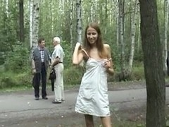 Russian cutie willingly showing natural tits in public