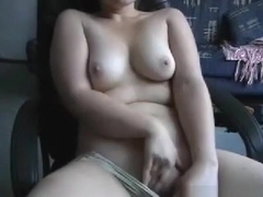 Chubby brunette girl rubs her shaved pussy on an ofice chair in the living room and tastes her pus.