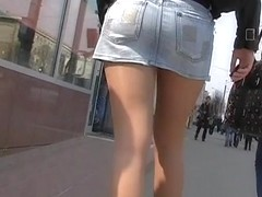 Upskirt of beauty in leather jacket