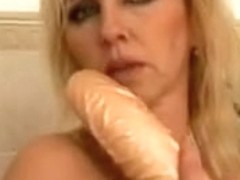Large tit tit mama in the bathrooom goes solol
