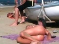 Flawless topless blond butt on the beach