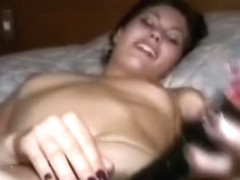 Cute young wife plays with her toys