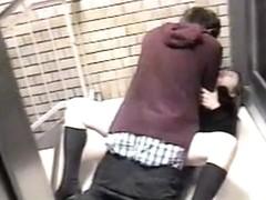 Public voyeur scene of an Asian couple fucking in the street