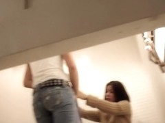Girl helps man try on jeans in the fitting room