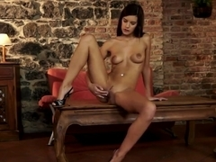 Glamour brunette Candice Luca is relaxing alone