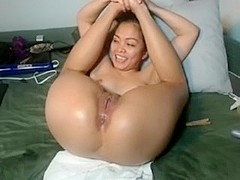 Sexy Asian chick enjoying humping an amateur anal dildo