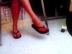 Girl dangling flip flops in the dark