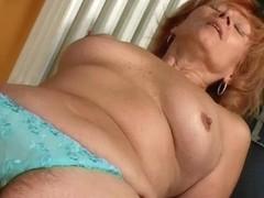 Redhead granny with hard nipps masturbates