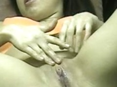 Gal masturbating and engulfing her boyfriend's dick