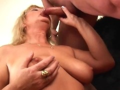 Breasty grandma squirts her cunt juice as that babe receives fingered