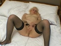 Blonde cutie masturbates her tasty pussy on the bed