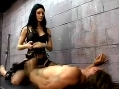 Hot Brunette Dominatrix Leah Wilde Whips Her Slave Behind Bars