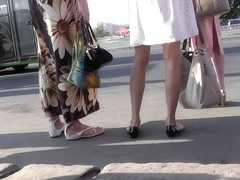 Blonde-haired girl with slender forms in upskirts video