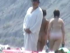 An enthralling nude beach voyeur video