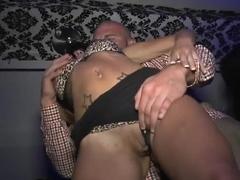 Two girls suck dicks at a dirty ass club