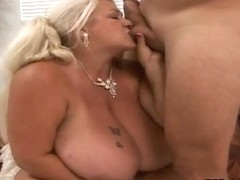 Mature Linda with gigantic tits sucks Jay