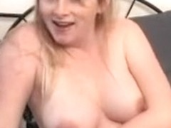 Pregnant blonde fondling her boobs