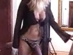 Lisa Berlin trains Thong-on Slaves in her cage!