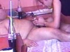 Dressed up Latina slut sucking a schlong on the bed