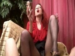 carnal footjob on couch in darksome stockings