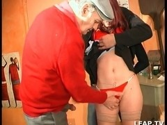 Two hard cocks double penetrate a French redheaded girl
