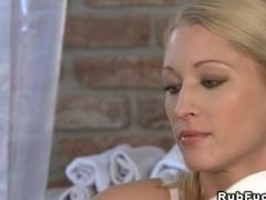 Small tittied masseuse gives footjob