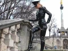 Sexy blonde lady shiny black policewoman
