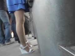 Upskirt voyeur video shows plump female in A-line skirt
