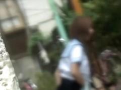 Sexy Japanese schoolgirl in a skirt sharking street video