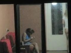 Brunette and blonde girls voyeured through hostel window