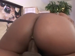 Black babe is sucking a rock hard meat stick and getting it inside her wet pussy