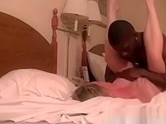 Filmed sexy interracial act in hotel room