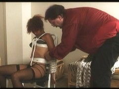 Hot dude and his doxy in S&M foreplay
